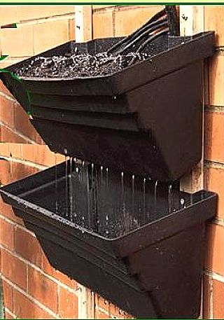 Adding watering systems to vertical pots makes your vertical garden very easy to manage